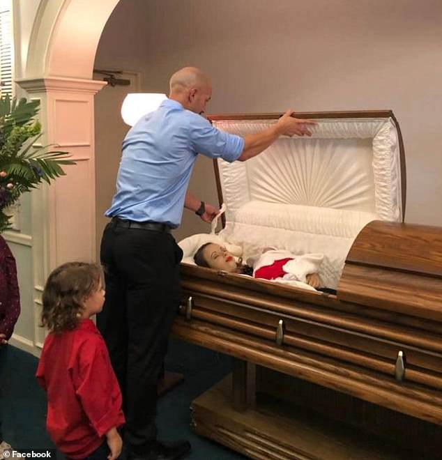 Images from the September 26 gathering at McWane Family Funeral Home were shared showing Krystil Kincaid, 29, and the daughter they planned to name Avalynn Onix in a casket